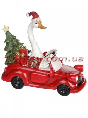 Декоративная статуэтка из полистоуна Гусь Рождественский в машине 14,5 см